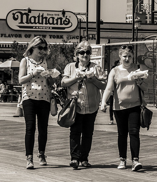 Russian ladies enjoying fastfood during spring-time stroll along the beach - Cony Island