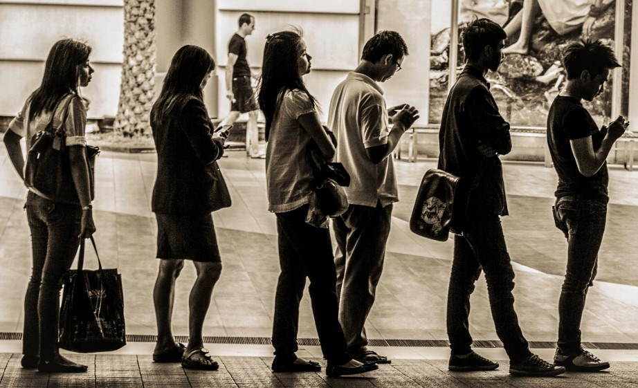 Photograph of people standing in line