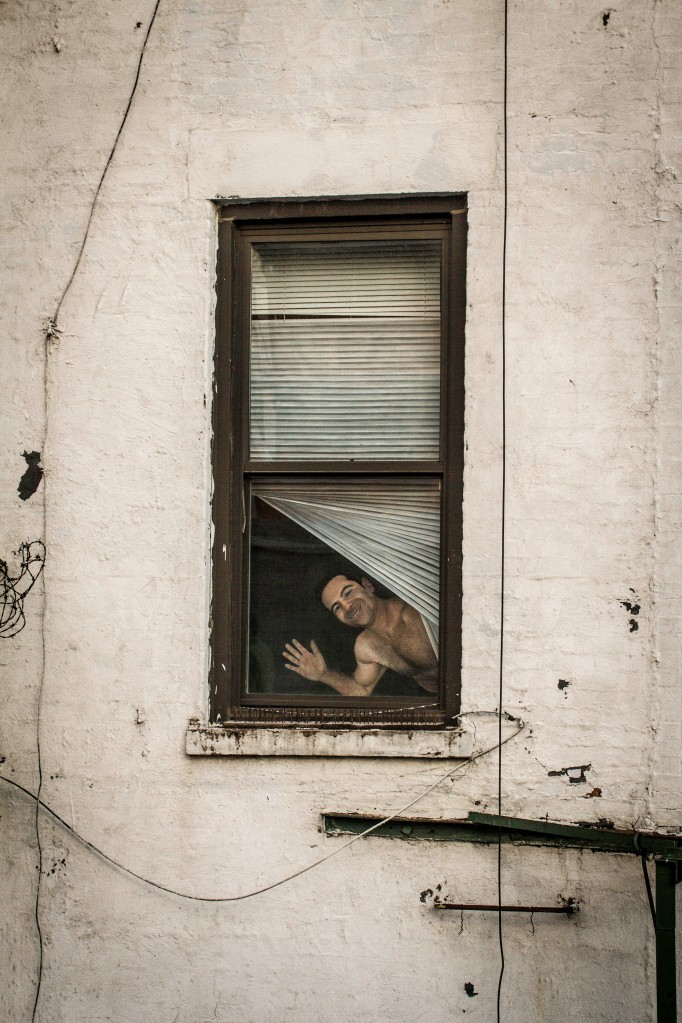 cardboard guy waving at window