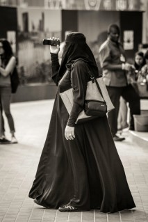 Woman in chador filming