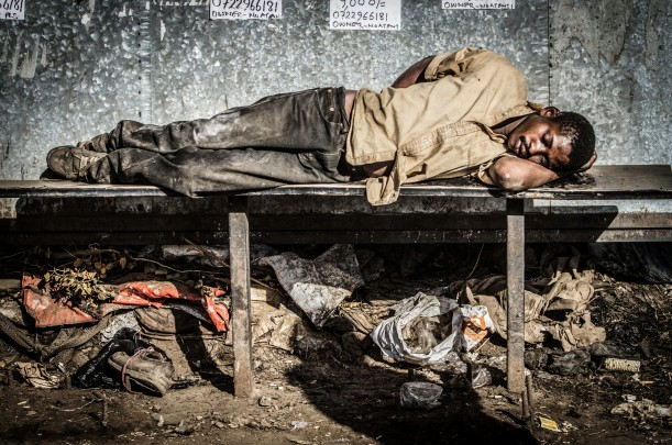 Photography of Kenyan man sleeping on a bench - Nairobi