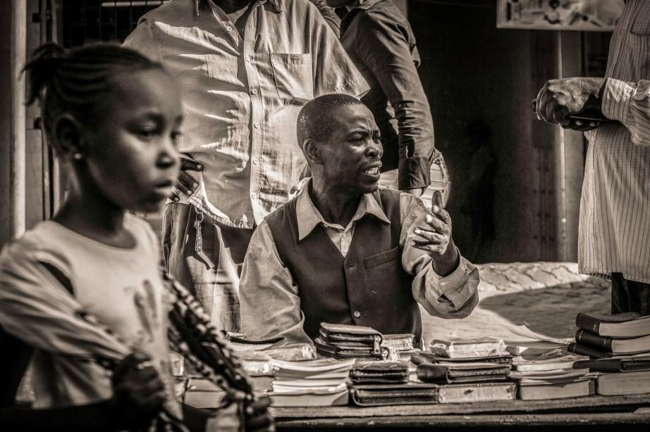 Photograph of Kenyan Man selling Bibles in the Market - Nairobi