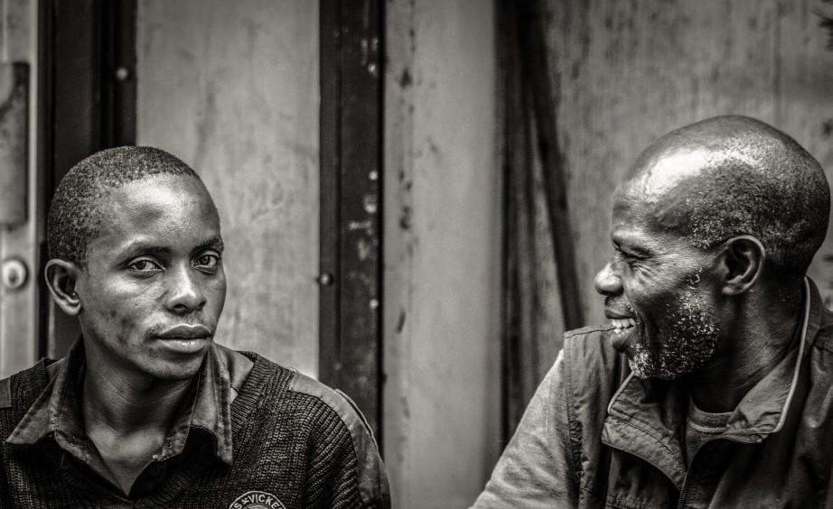 Portrait of two men having a chat