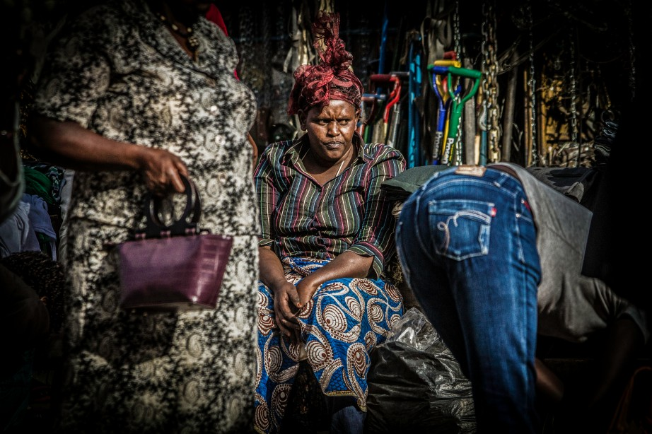 Photograph of Kenyan woman in the market looking annoyed