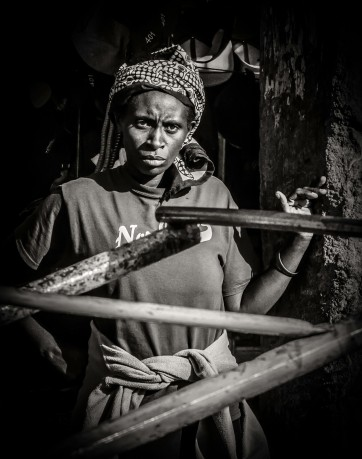 Monochrome photograph of seemingly worried woman - Kenya