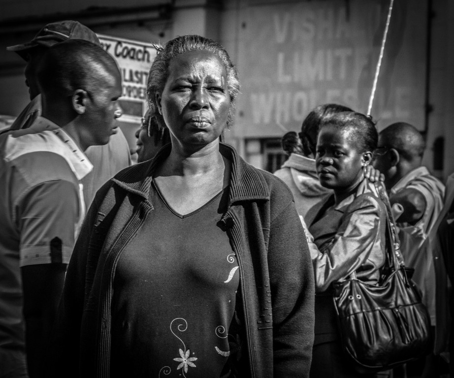 Monochrome photograph of elderly women standing  - Kenya