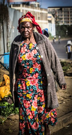Photograph of elderly Kenyan woman in colorful dress