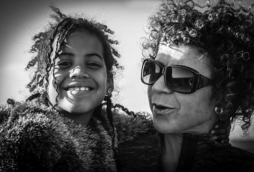 Monochrome portrait of mother and daughter with curls