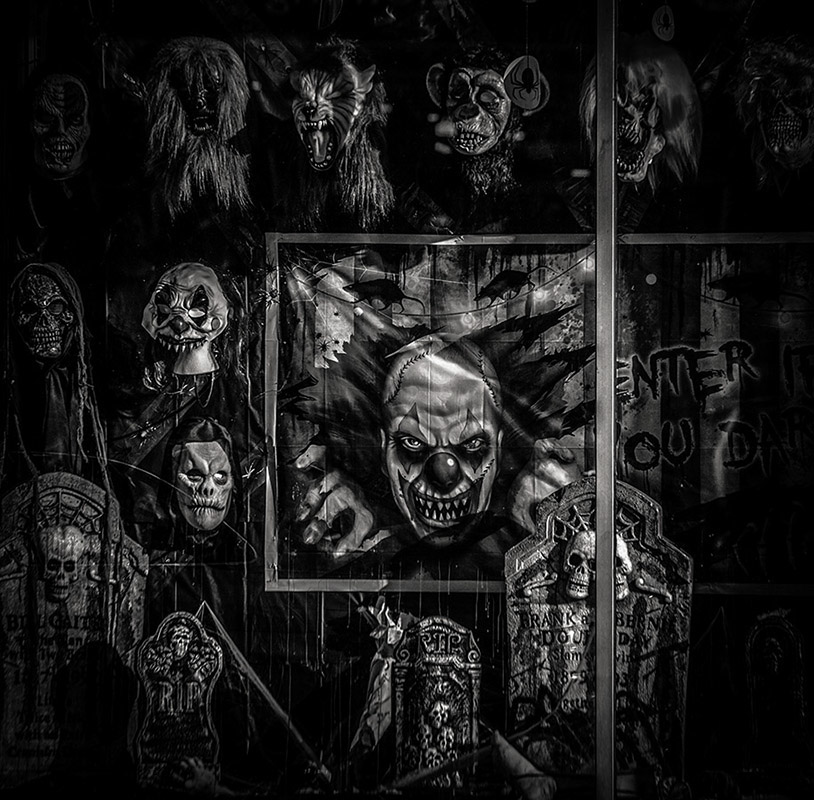 Monochrome detail of display with Halloween masks