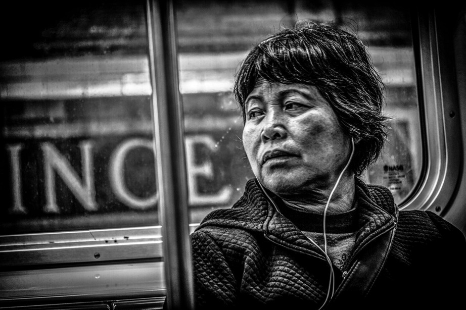 Monochrome Portrait of Asian Lady on Train