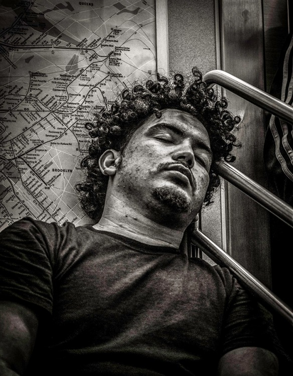 Monochrome Portrait of sleeping man with curls
