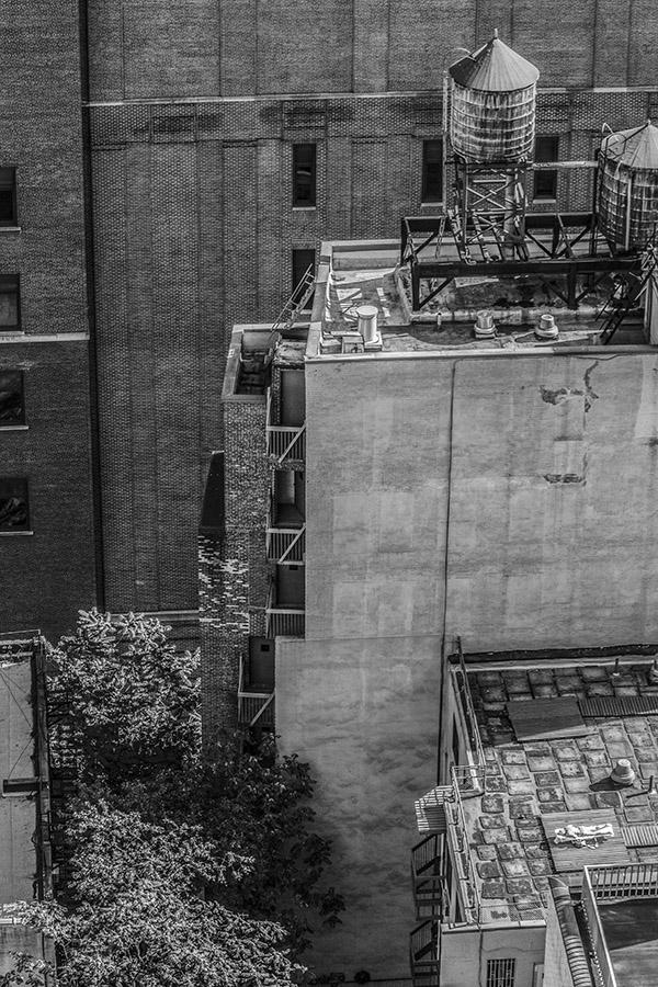 Monochrome, woman sunbathing on rooftop