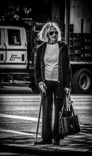 Portrait series of elderly lady with youngish hairstyle in street - part 1