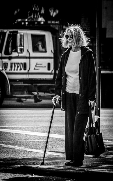 Portrait series of elderly lady with youngish hairstyle in street - part 3