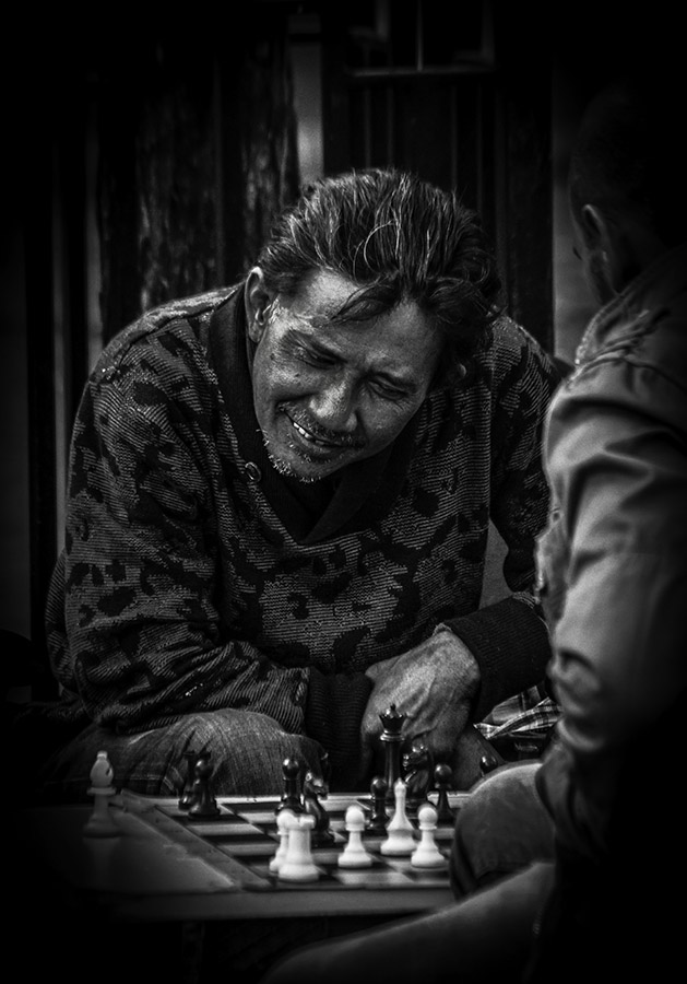 B&W portrait of man playing chess