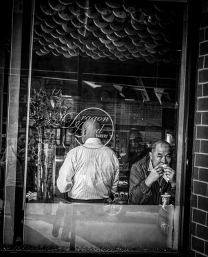 B&W Street Shot through window: Chinese Bakery