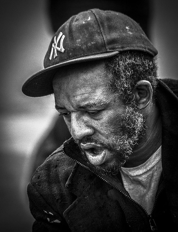 Monochrome Portrait of elderly man with NY basecap