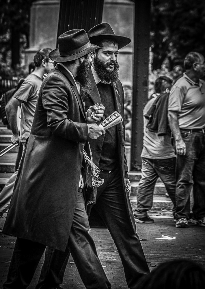 Monochrome Street Shot of Two Orthodox Jews hurrying across Union Square