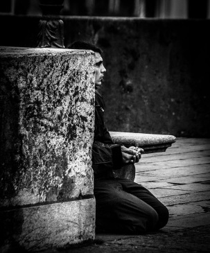 B&W street shot of man begging