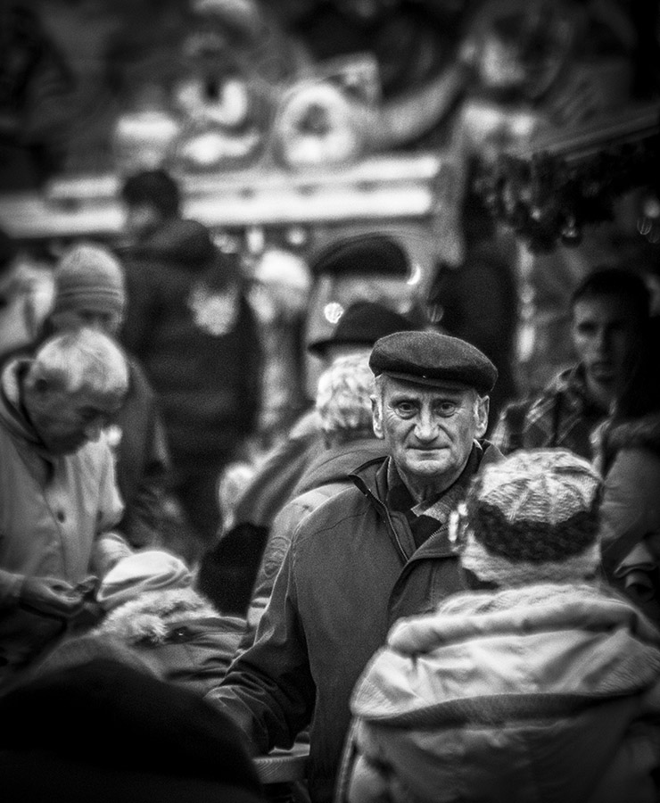 Monochrome Street Shot of Old Man in a Crowd