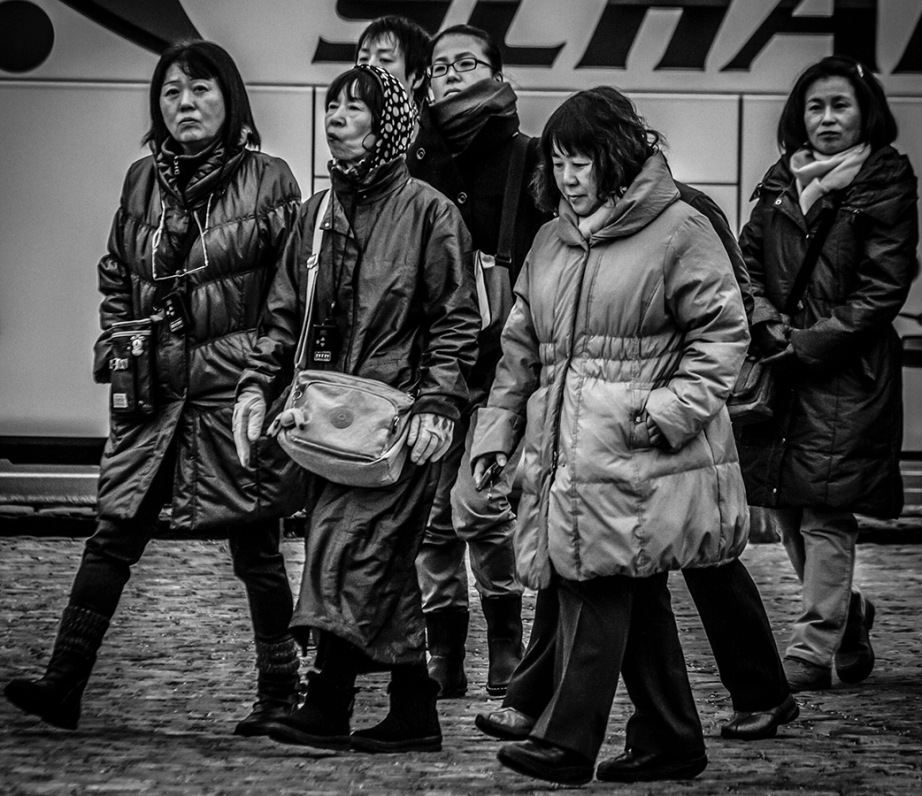 B&W street shot of Japanese group of tourists