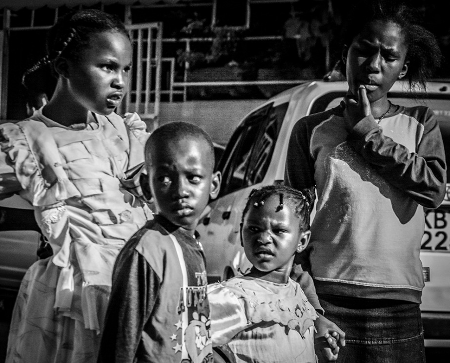 Monochrome snapshot of Kenyan kids making funny faces
