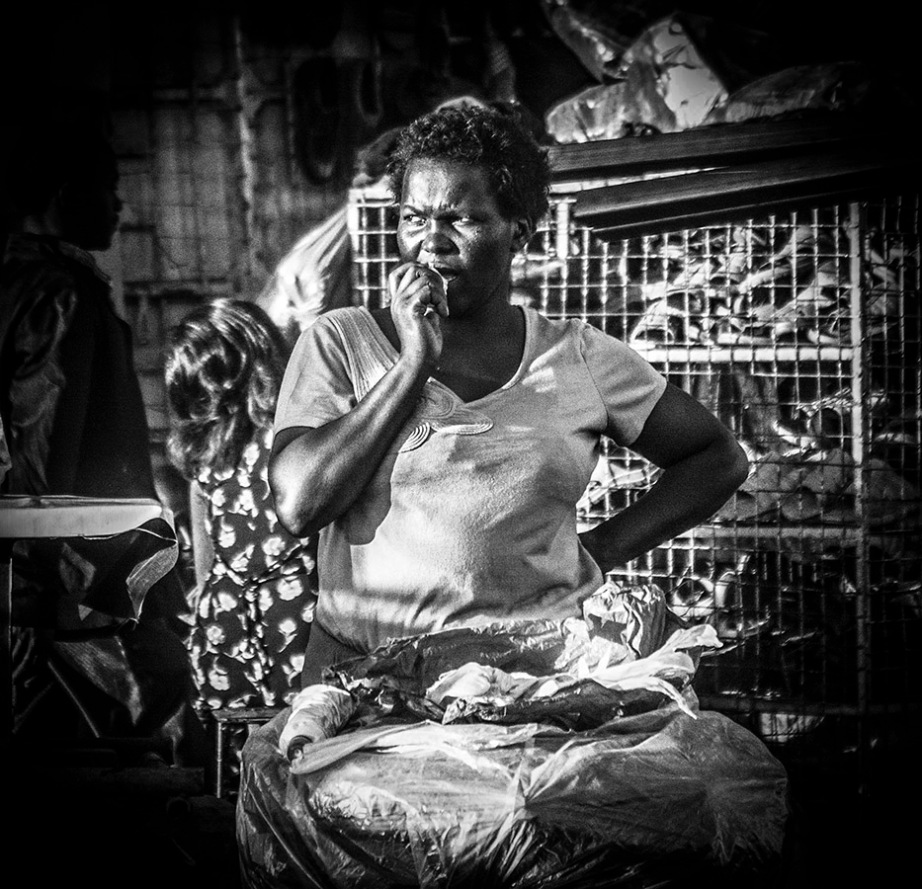 Market Woman Munching Bread - Downtown Nairobi